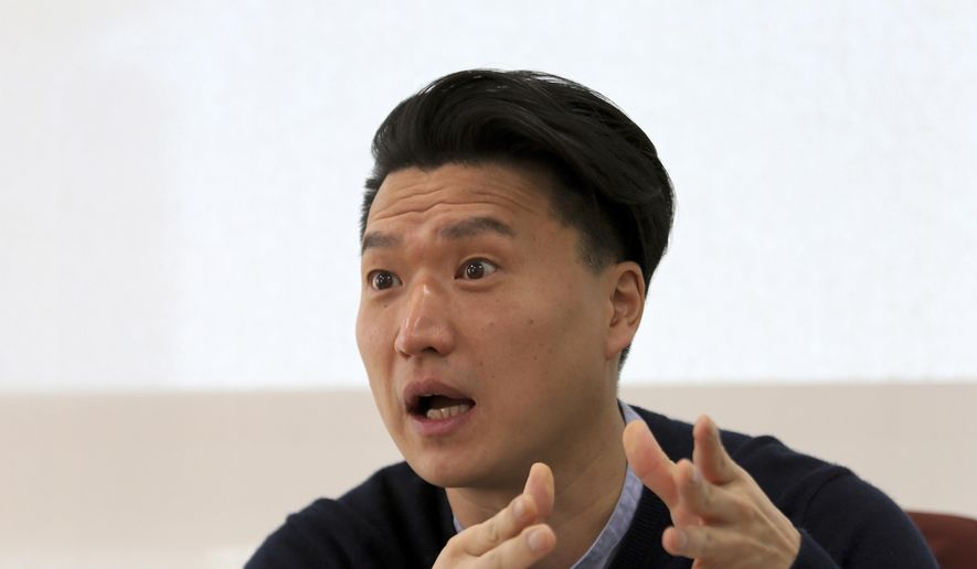 In this Jan. 2, 2019, photo, South Korean adoptee Adam Crapser speaks during an interview in Seoul, South Korea. Crasper was deported from the U.S. four decades after his adoption by American parents is suing the Seoul government and a private adoption agency over what he calls gross negligence. (AP Photo/Ahn Young-joon)