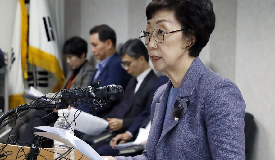 In this Tuesday, Jan. 22, 2019, photo, Choi Young-ae, head of the National Human Rights Commission, speaks on human rights conditions in sports circles during a press conference in Seoul, South Korea. South Korea's human rights commission plans to interview possibly thousands of athletes about a culture of abuse in sports after a wave of female athletes came forward to say they had been raped or assaulted by their coaches. (Choe Dong-jun/Newsis via AP)