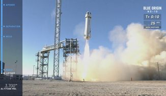 In this image from video made available by Blue Origin, the New Shepard capsule and booster lifts off from the company's site in west Texas. Jeff Bezos' rocket company launched NASA experiments into space on the brief test flight. (Blue Origin via AP)