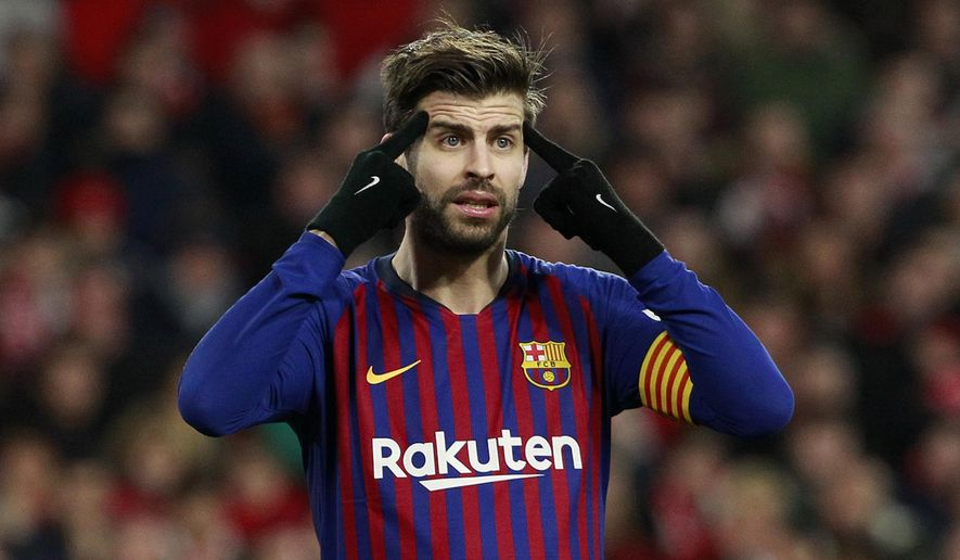FC Barcelona's Gerard Pique gestures during a Spanish Copa del Rey soccer match between Sevilla and FC Barcelona at the Ramon Sanche Pizjuan stadium in Seville, Spain, Wednesday Jan. 23, 2019. (AP Photo/Miguel Morenatti)