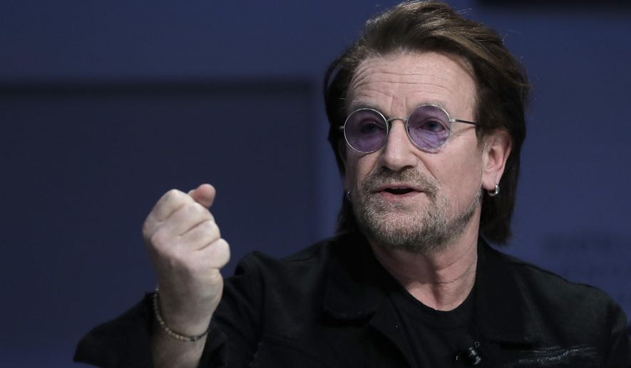 "Singer and co-founder of RED Bono gestures while participating in the ""Closing the Financing Gap"" session at the annual meeting of the World Economic Forum in Davos, Switzerland, Wednesday, Jan. 23, 2019. (AP Photo/Markus Schreiber)"