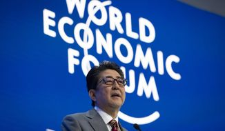 Shinzo Abe, Prime Minister of Japan, speaks during a plenary session in the Congress Hall at the 49th annual meeting of the World Economic Forum, WEF, in Davos, Switzerland, Wednesday, Jan. 23, 2019. T(Gian Ehrenzeller/Keystone via AP)