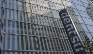 The headquarters of Japanese advertising company Dentsu Inc. is seen in Tokyo Wednesday, Jan. 23, 2019. One of Japan's most powerful companies, the giant agency Dentsu Inc. is part of an investigation into alleged vote-buying connected with landing the 2020 Olympics for Tokyo. (AP Photo/Eugene Hoshiko)
