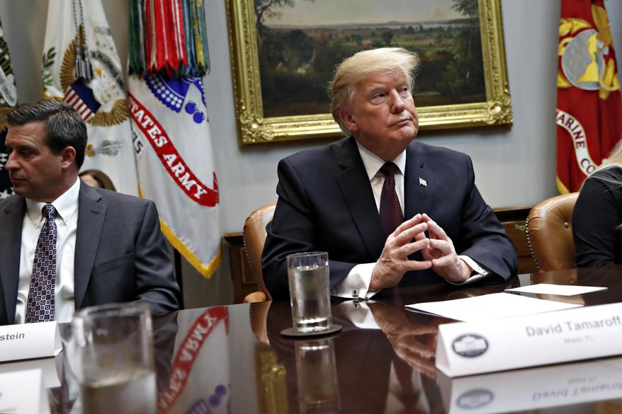 President Donald Trump listens during a healthcare roundtable in the Roosevelt Room of the White House, Wednesday, Jan. 23, 2019, in Washington. At left is David Silverstein, of Denver. (AP Photo/Jacquelyn Martin) **FILE**