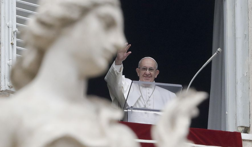 """Pope Francis waves to the crowd gathered to attend the Angelus noon prayer he recited from the window of his studio overlooking St. Peter's Square, at the Vatican, Sunday, Jan. 20, 2019. Pope Francis has prayed for peace in Colombia after the Bogota bombing at a police academy. Francis told the faithful in St. Peter's Square Sunday that he wanted to assure the Colombian people of his closeness after the """"grave terrorist attack"""" on Jan. 17 that claimed 21 lives. (AP Photo/Andrew Medichini) ** FILE **"""