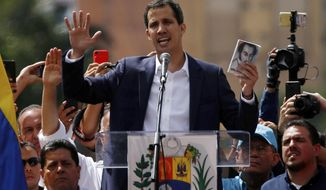 Juan Guaido, head of Venezuela's opposition-run congress, declares himself interim president of Venezuela, during a rally demanding President Nicolas Maduro's resignation in Caracas, Venezuela, Wednesday, Jan. 23, 2019. (AP Photo/Fernando Llano)