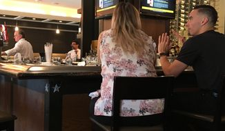 Customers enjoy Happy Hour at Chef Geoffs in Vienna, Va., Friday, June 15, 2018. Restaurant owner Geoff Tracy is suing members of the state Alcoholic Control Board seeking to invalidate its restrictive rules on happy hour advertising. (Ap Photo/Matt Barakat)