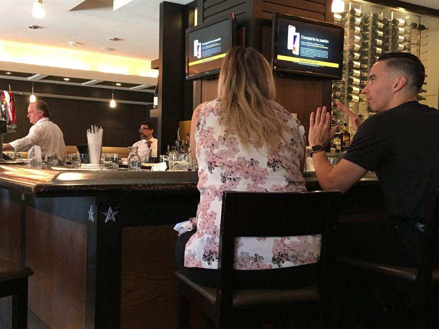 Customers enjoy Happy Hour at Chef Geoffs in Vienna, Va., Friday, June 15, 2018. (Ap Photo/Matt Barakat)