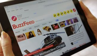 FILE- In this Sept. 2, 2015, file photo the BuzzFeed website is displayed on an iPad held by an Associated Press staffer in Los Angeles. Media company BuzzFeed is cutting 15 percent of its jobs, or about 200 people, to trim costs and become profitable. BuzzFeed CEO Jonah Peretti said in a memo to employees Wednesday, Jan. 23, 2019, that the layoffs will help BuzzFeed avoid having to raise money from investors again. (AP Photo/Richard Vogel, File)