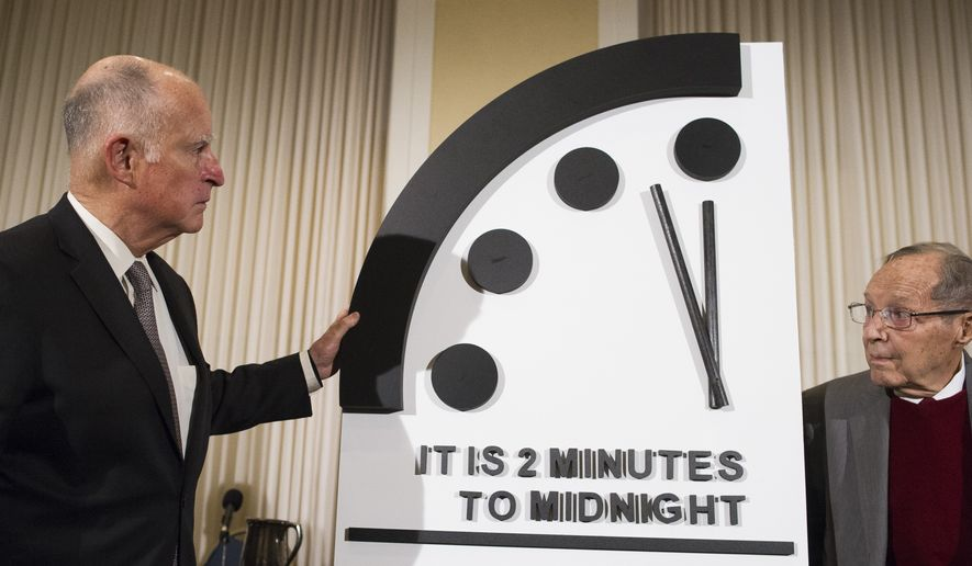 Former California Gov. Jerry Brown, left, and former Secretary of Defense William Perry unveil the Doomsday Clock during The Bulletin of the Atomic Scientists news conference in Washington, Thursday, Jan. 24, 2019. The Doomsday Clock is set at two minutes to Midnight. (AP Photo/Cliff Owen) ** FILE **