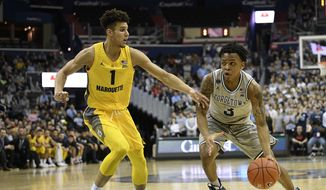 Georgetown guard James Akinjo (3) dribbles the ball against Marquette forward Brendan Bailey (1) during the second half of an NCAA college basketball game, Tuesday, Jan. 15, 2019, in Washington. Marquette won 74-71. (AP Photo/Nick Wass) **FILE**
