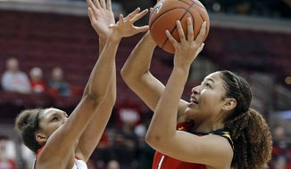 Maryland forward Shakira Austin (1) goes up for a basket against Ohio State forward Aaliyah Patty (32) during the first half of an NCAA college basketball game in Columbus, Ohio, Thursday, Jan. 24, 2019. (Kyle Robertson/The Columbus Dispatch via AP) **FILE**