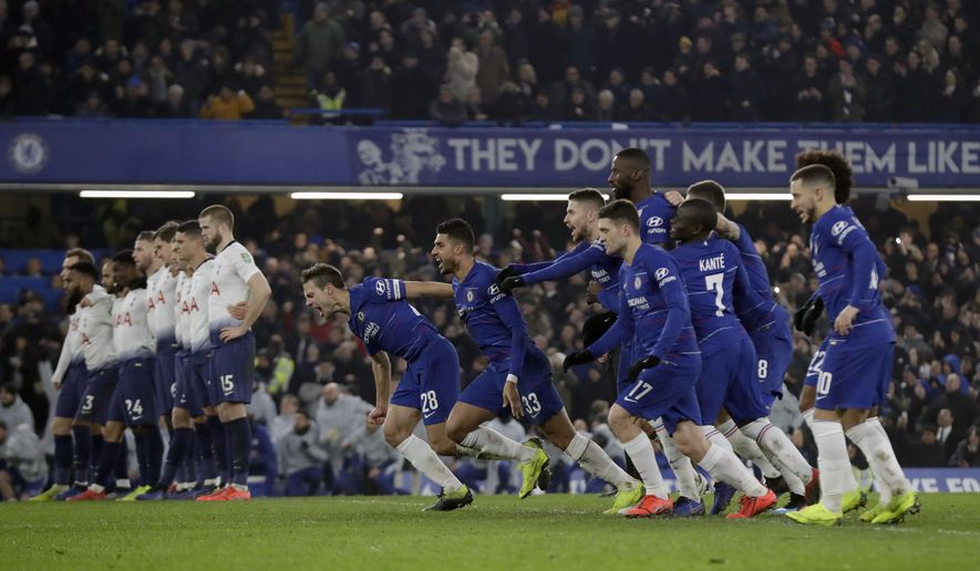 Chelsea players celebrate after Chelsea's David Luiz scores the winning penalty in a shootout at the end the second leg of the English League Cup semifinal soccer match between Chelsea and Tottenham Hotspur at Stamford Bridge stadium in London, Thursday, Jan. 24, 2019. (AP Photo/Matt Dunham)