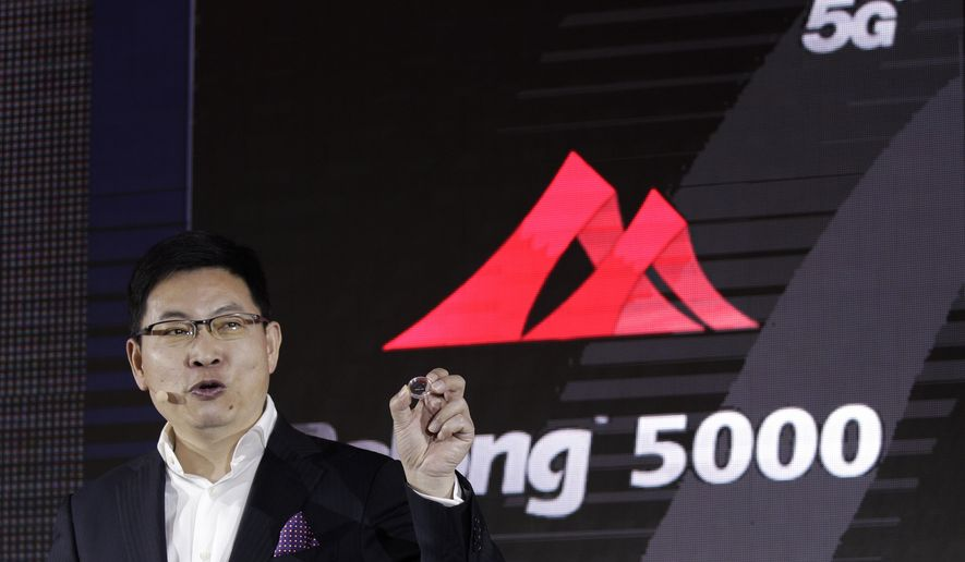 Richard Yu, CEO of Huawei Consumer Business Group speaks as he unveils the 5G modem Balong 5000 chipset in Beijing, Thursday, Jan. 24, 2019. Chinese tech giant Huawei has announced plans to release a next-generation smartphone based on its own technology instead of U.S. components, stepping up efforts to compete with global industry leaders. (AP Photo/Andy Wong)