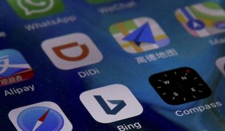 Microsoft Corp.'s Bing appp is seen with other mobile apps on a smartphone in Beijing, Thursday, Jan. 24, 2019. Chinese internet users have lost access to Microsoft Corp.'s Bing search engine, triggering grumbling about the ruling Communist Party's increasingly tight online censorship. (AP Photo/Andy Wong)
