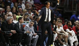 Miami Heat head coach Erik Spoelstra gestures toward players during the first half of an NBA basketball game against the Los Angeles Clippers, Wednesday, Jan. 23, 2019, in Miami. (AP Photo/Brynn Anderson)