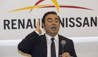 FILE - In this April 25, 2016, file photo, then Renault-Nissan's CEO Carlos Ghosn speaks during a press conference held at the Auto China 2016 in Beijing. French Finance Minister Bruno Le Maire said Thursday, Jan. 24, 2019, that Ghosn, who is fighting breach of trust and other charges in Japan, resigned as head of Renault. (AP Photo/Ng Han Guan, File)