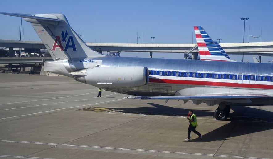 FILE- In this Nov. 5, 2018, file photo American Airlines aircraft are serviced at Dallas/Fort Worth International Airport, in Texas. American Airlines reports financial results Thursday, Jan. 24, 2019. (AP Photo/Mike Stewart, File)