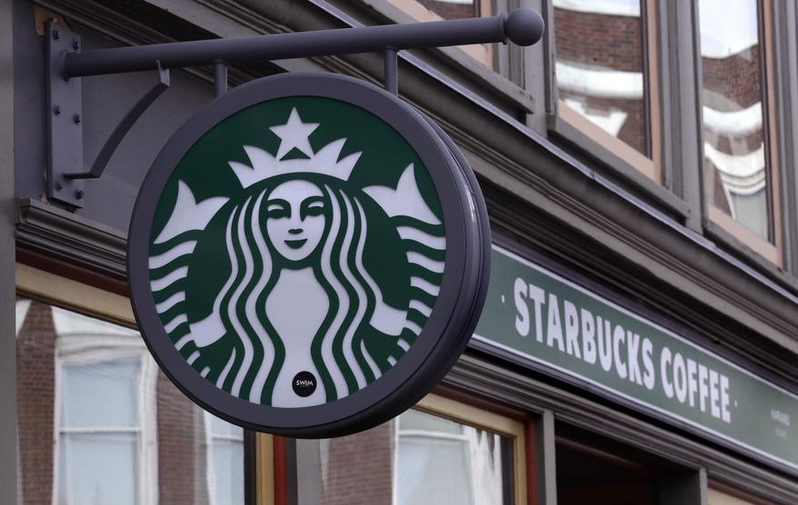 This Dec. 13, 2018, file photo shows a sign for a Starbucks Coffee shop in Harvard Square in Cambridge, Mass. Starbucks Corp. reports financial results Thursday, Jan. 24, 2019. (AP Photo/Charles Krupa, File)