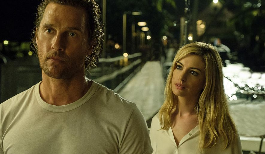 "This image released by Aviron Pictures shows Matthew McConaughey, left, and Anne Hathaway in a scene from ""Serenity."" (Graham Bartholomew/Aviron Pictures via AP)"