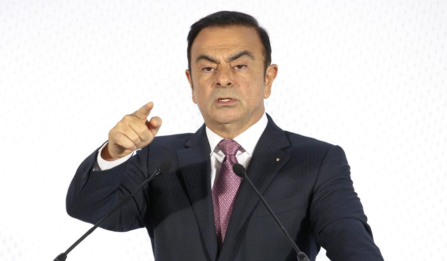 In this Feb. 12, 2015, file photo, then-Chairman and CEO of Renault-Nissan Carlos Ghosn addresses media during a press conference held in Paris. (AP Photo/Jacques Brinon, File)