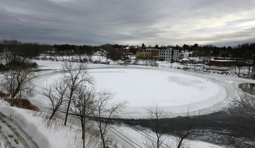 A naturally occurring ice disk that gained international fame appears to be freezing in place following a stretch of frigid weather, Wednesday, Jan. 23, 2019, in Westbrook, Maine. The giant ice disk on the Presumpscot River now has its own webcam. (AP Photo/Robert F. Bukaty)