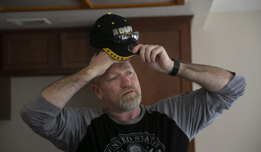 """Chris George, a federal employee furloughed from his job as a forestry technician supervisor for the U.S. Department of Agriculture Forest Service, takes a short break while working as a handyman to make ends meet Saturday, Jan. 19, 2019, in Fontana, Calif. """"I have a lot of pride, so asking for help is difficult for me. It's very difficult for me because I'm always the one giving back or putting myself before anybody else,"""" said George. """"Now, here I am in the situation where I'm the one that is in need."""" (AP Photo/Jae C. Hong)"""