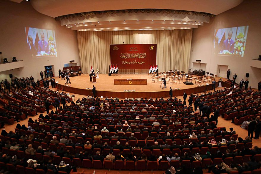 FILE - in this Monday, Sept. 3, 2018, file photo, Iraqi lawmakers attend a parliament session in Baghdad, Iraq. Iraq's parliament on Thursday, Jan. 24 has approved a national budget for 2019 after weeks of wrangling over how to apportion revenues between the regions damaged by the war against the Islamic State group. (AP Photo/Karim Kadim, File)