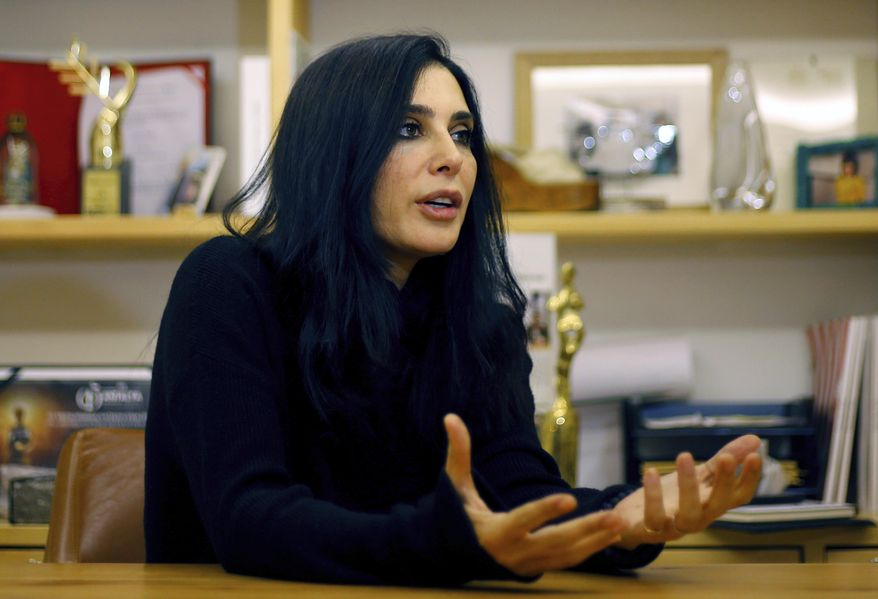 In this Tuesday, Jan. 22, 2019 photo, Lebanese director Nadine Labaki, speaks during an interview with The Associated Press in Beirut, Lebanon. Labaki, a source of national pride, has become the first female artist in the Arab world to be nominated for an Oscar. She is also the only woman director to compete for a prize at this year's Academy Awards. Capernaum, her masterful neo-realist drama about a 12-year old Syrian refugee boy and a Kenyan toddler who live parentless on the streets of Beirut was nominated for the Golden Globes. (AP Photo/Bilal Hussein)