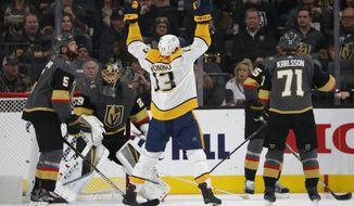 Nashville Predators center Nick Bonino (13) celebrates after scoring against the Vegas Golden Knights during the second period of an NHL hockey game Wednesday, Jan. 23, 2019, in Las Vegas. (AP Photo/John Locher)