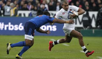 FILE - In this Saturday, March 19, 2016 file photo, England's Anthony Watson, right, evades France's Wesley Fofana during their Six Nations international rugby match at the Stade de France stadium in Saint-Denis, outside Paris. France center Wesley Fofana will retire from international rugby after the World Cup later this year, it was announced Thursday, Jan. 24, 2019.  A powerful, fast center with good hands, the 31-year-old Fofana made his international debut against Italy seven years ago and scored 15 tries in 45 test appearances. (AP Photo/Thibault Camus, file)