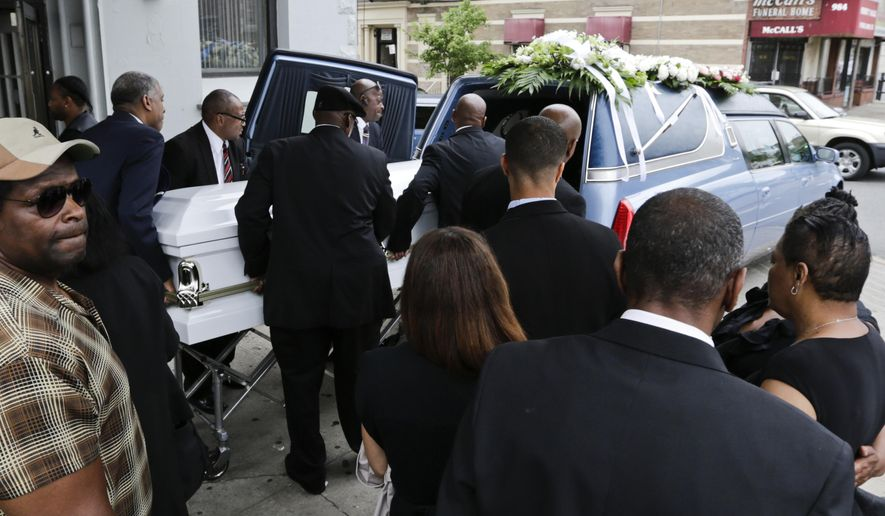 FILE - In this June 16, 2015 file photo, the casket bearing Kalief Browder is loaded into a hearse after his funeral service in the Bronx borough of New York. On Thursday, Jan. 24, 2019, New York City officials said that the City will pay $3 million to Browder's family. Browder's long detention, nearly half of it spent in solitary confinement at the Rikers Island jail and suicide at age 22, made him a symbol of a broken justice system. (AP Photo/Frank Franklin II, File)