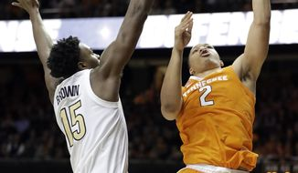 Tennessee forward Grant Williams (2) scores against Vanderbilt forward Clevon Brown (15) in the second half of an NCAA college basketball game Wednesday, Jan. 23, 2019, in Nashville, Tenn. Williams scored a career-high 41 points and was 23 for 23 at the free throw line as Tennessee won 88-83 in overtime. (AP Photo/Mark Humphrey)