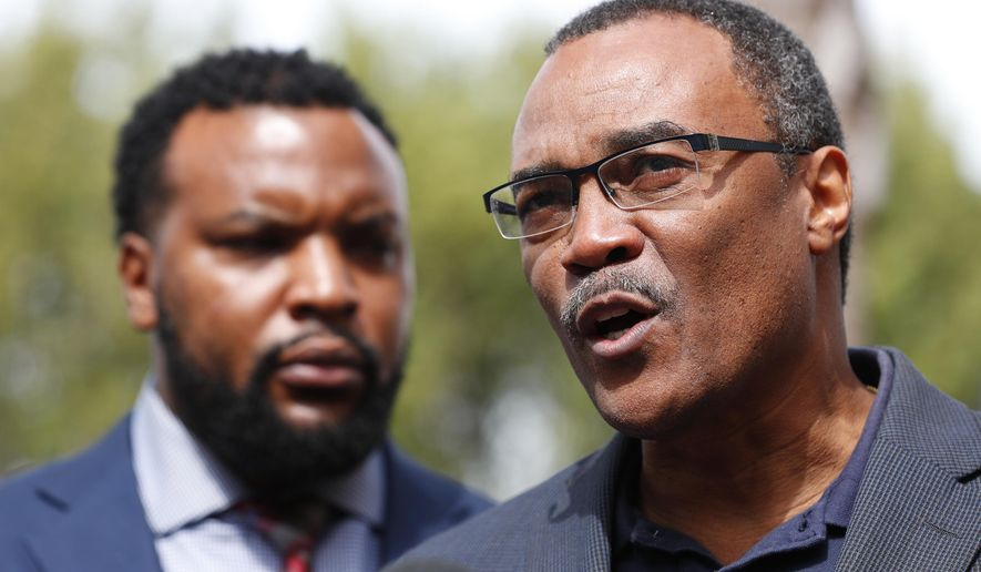 Don Horn, right, Chief Assistant State Attorney for Administration, speaks during a news conference along with attorney Lee Merritt, left, representing a group of teenagers, Thursday, Jan. 24, 2019, in Miami. Video surfaced of a traffic confrontation between the teens, who were demonstrating in the streets, and Mark Bartlett, who was charged with a weapons violation after he confronted the teens while holding a gun. Prosecutors have begun taking sworn statements from the teens as they weigh possible hate crime charges against Bartlett who confronted them during a housing inequality protest on Martin Luther King Day. (AP Photo/Wilfredo Lee)