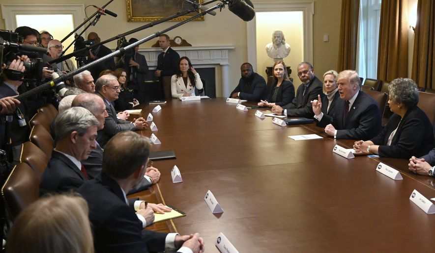 President Donald Trump, second from right, speaks in the Cabinet Room of the White House in Washington, Wednesday, Jan. 23, 2019, as he hosts a roundtable with conservative leaders to discuss the security and humanitarian crisis at the southern border. (AP Photo/Susan Walsh)