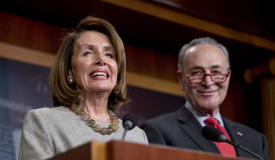 House Speaker Nancy Pelosi of Calif., and Senate Minority Leader Sen. Chuck Schumer of N.Y., smile during a news conference on Capitol Hill in Washington, Friday, Jan. 25, 2019, after President Donald Trump announces a deal to reopen the government for three weeks. (AP Photo/Andrew Harnik)