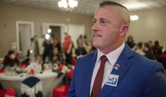 FILE - In this Tuesday, Nov. 6, 2018 file photo, Richard Ojeda, Democratic candidate for West Virginia's 3rd Congressional district, watches election results during his campaign's watch party at Special Occasions in Yuma, W.Va. Ojeda, a tattooed veteran who recently ran for Congress, says he isn't getting the money or attention needed to sustain a campaign for President. (Dylan Vidovich/The Logan Banner via AP, File)