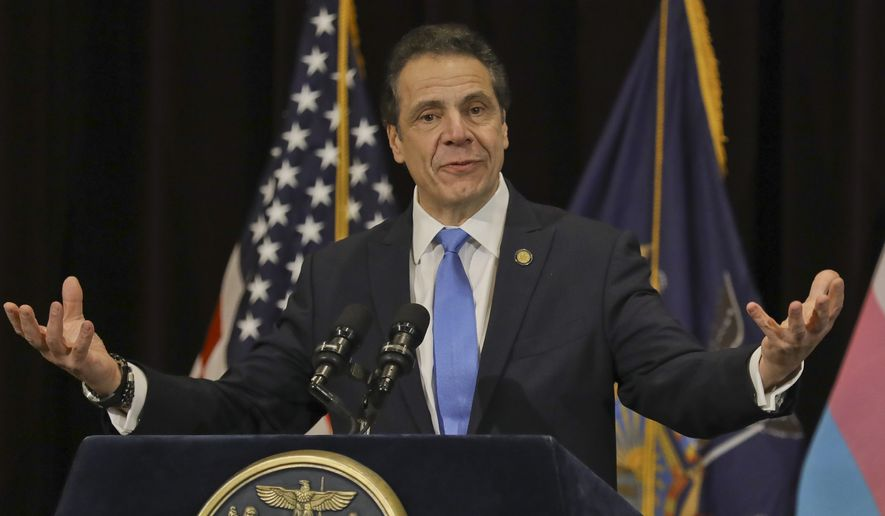 New York Gov. Andrew Cuomo speaks before signing an anti-discrimination bill into law, Friday Jan. 25, 2019 in New York. New York state added gender identity and gender expression to the state's anti-discrimination law, making it illegal to deny people a job, housing, education or public accommodations because they are transgender. (AP Photo/Bebeto Matthews)