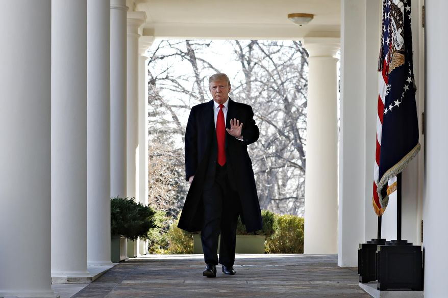 President Donald Trump waves as he walks through the Colonnade  from the Oval Office of the White House on arrival to announce a deal to temporarily reopen the government, Friday, Jan. 25, 2019, from the Rose Garden of the White House in Washington. (AP Photo/Jacquelyn Martin)