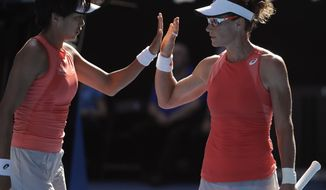 China's Zhang Shuai, left, and Australia's Samantha Stosur celebrate a point win over France's Kristina Mladenovic and Hungary's Timea Babos during the women's doubles final at the Australian Open tennis championships in Melbourne, Australia, Friday, Jan. 25, 2019. (AP Photo/Mark Schiefelbein)
