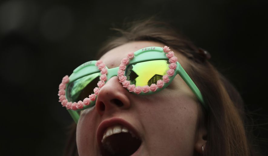 A young girl shouts slogans as she marches with other thousands during a climate change protest in Brussels, Thursday, Jan. 24, 2019. Thousands of students skipped school for the third week in a row and more than 30.000 swamped the centre of Brussels to demand better protection of the world's climate. (AP Photo/Francisco Seco)