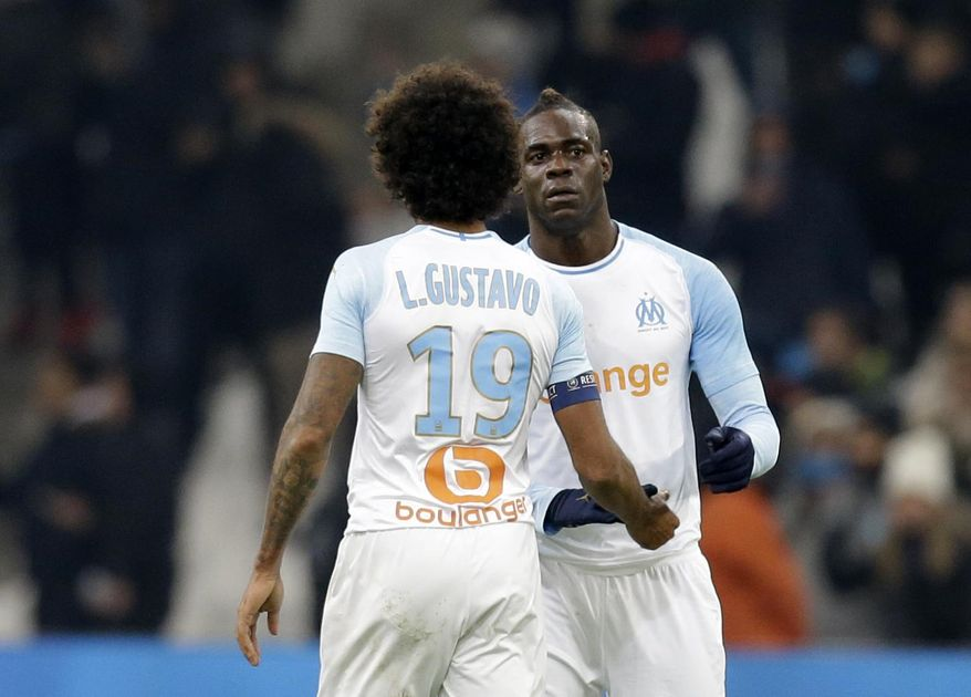 Marseille's Mario Balotelli celebrates after scoring his side's first goal of the game during a French League One soccer match between Olympique Marseille and Lille at the Stade Velodrome in Marseille, France, Friday, Jan. 25, 2019. (AP Photo/Claude Paris)