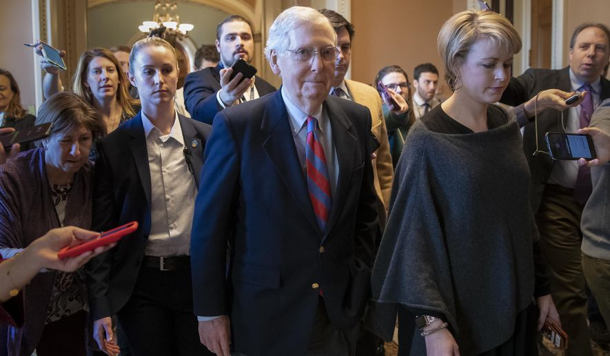 Senate Majority Leader Mitch McConnell, R-Ky., leaves the chamber as President Donald Trump and congressional leaders reached a short-term deal to reopen the government for three weeks, at the Capitol in Washington, Friday, Jan. 25, 2019. Negotiations will continue over the president's demands for money to build his long-promised wall at the U.S.-Mexico border. (AP Photo/J. Scott Applewhite)