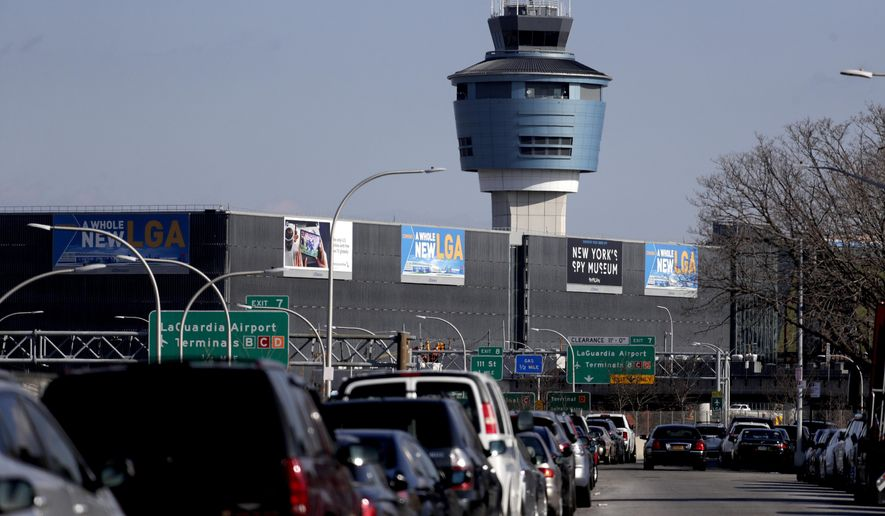 """The air traffic control tower at LaGuardia Airport is seen, Friday, Jan. 25, 2019, in New York. The Federal Aviation Administration reported delays in air travel Friday because of a """"slight increase in sick leave"""" at two East Coast air traffic control facilities.  (AP Photo/Julio Cortez)"""
