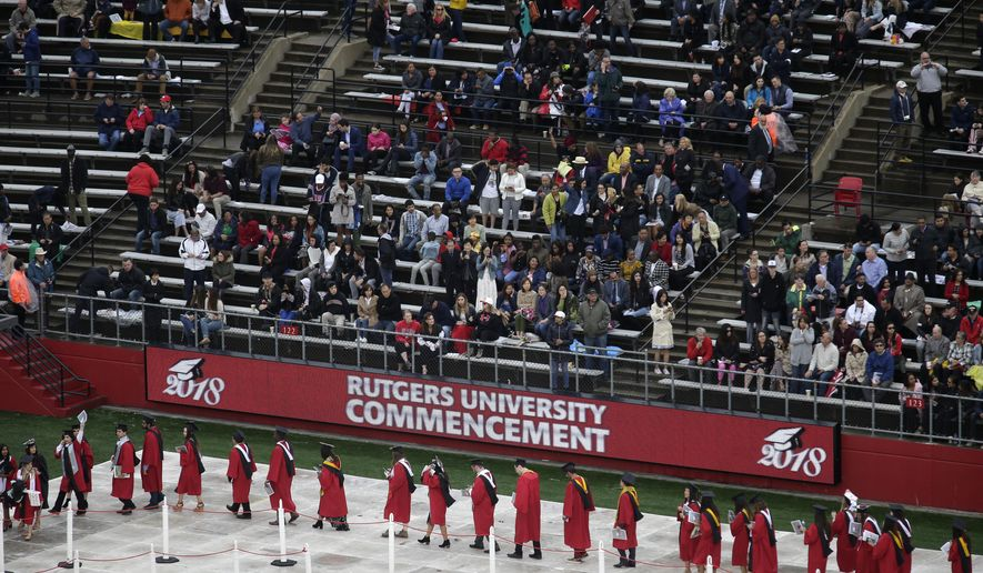 In this May 13, 2018, file photo, new graduates walk into the High Point Solutions Stadium before the start of the Rutgers University graduation ceremony in Piscataway Township, N.J. A growing number of colleges and universities are postponing tuition deadlines, waiving late fees and providing emergency grants to students whose finances have been tied up by the longest government shutdown in history. Among the latest to advertise help are Brown University, Rutgers University and the State University of New York system. (AP Photo/Seth Wenig, File)