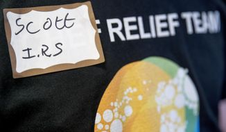 Scott, a furloughed government worker with the IRS volunteers his time to hand out free food and supplies to other furloughed government workers affected by the shutdown at World Central Kitchen, the not-for-profit organization started by Chef Jose Andres, Tuesday, Jan. 22, 2019 in Washington. The organization devoted to providing meals in the wake of natural disasters, has set up a distribution center just blocks from the U.S. Capitol building to assist those affected by the government shutdown. (AP Photo/Andrew Harnik)
