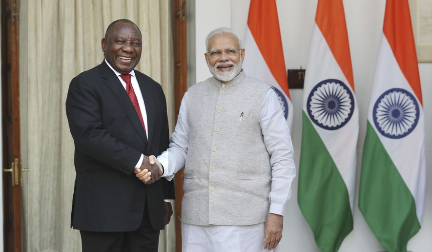 Indian Prime Minister Narendra Modi, right, shakes hand with South African President Cyril Ramaphosa, before a delegation level meeting in New Delhi, India, Friday, Jan. 25, 2019. Ramaphosa is on a two-day state visit to India and will be the chief guest at India's Republic Day parade celebrating the country's anniversary of its national constitution taking effect. (AP Photo/Manish Swarup)