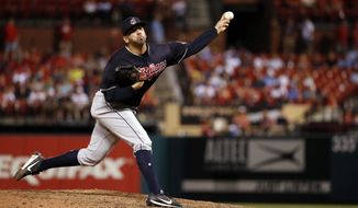 FILE - In this June 27, 2018, fil photo, Cleveland Indians relief pitcher Oliver Perez throws during the eighth inning of a baseball game against the St. Louis Cardinals, in St. Louis. The Indians have re-signed free agent reliever Oliver Perez for next season.(AP Photo/Jeff Roberson, File)