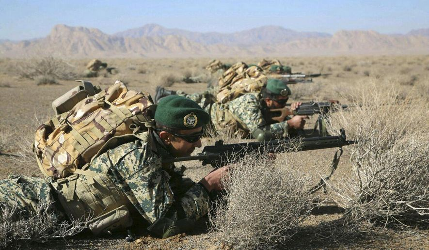 In this photo provided Friday, Jan. 25, 2019, by the Iranian Army, soldiers take position in an infantry drill in the central Isfahan province, Iran. (Iranian Army via AP)