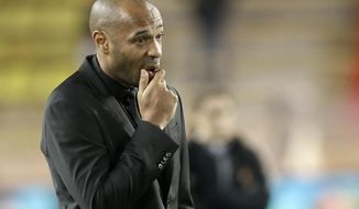 FILE - In this Nov. 6, 2018, file photo, Monaco coach Thierry Henry watches the players as they train before the Champions League Group A soccer match against Club Brugge at the Louis II stadium in Monaco. Monaco fired Henry and re-hired title-winning coach Leonardo Jardim on Friday, Jan. 25, 2019, just three months after sacking him to make way for the France great. (AP Photo/Claude Paris, File)